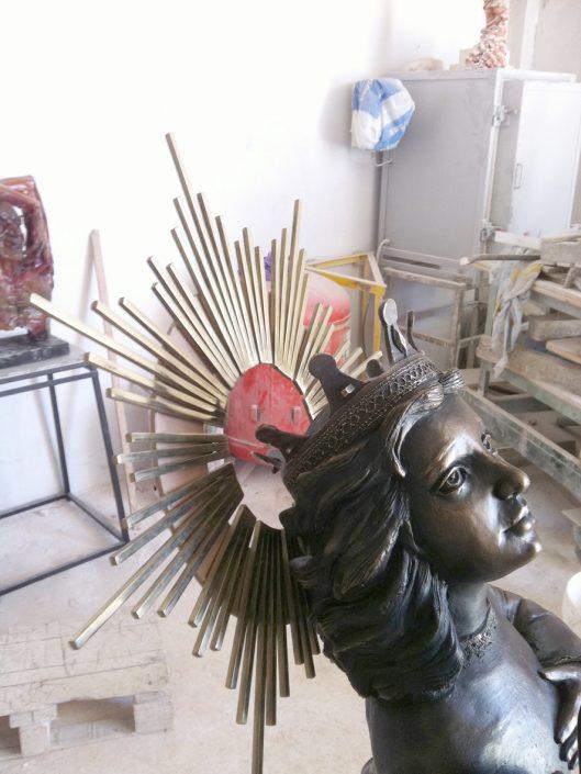 figura religiosa bronce pátina