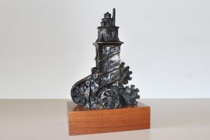 trofeo en resina torre hércules