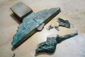 reparación figuras resina