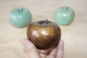 manzanas de bronce